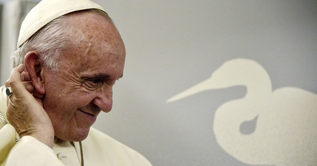 The Latest: Pope: possessing nuclear weapons 'irrational'