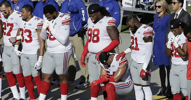 The Latest: 7 Seahawks players continue anthem protest