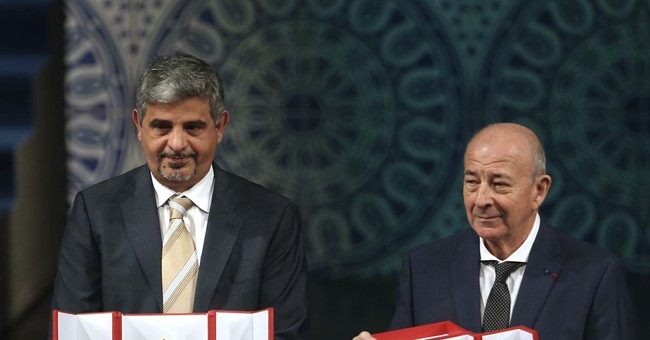 Iran gives Muslim scientist prize to Turkish-French, Iranian
