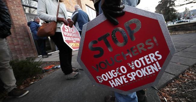 Colorado school board votes to end voucher program