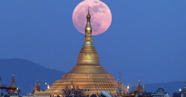 Image of Asia: Supermoon rises behind Myanmar pagoda