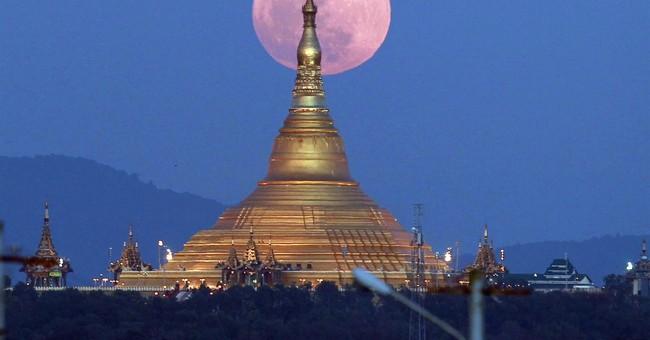 Image of Asia: Supermoon rises behind Myanmar pagoda