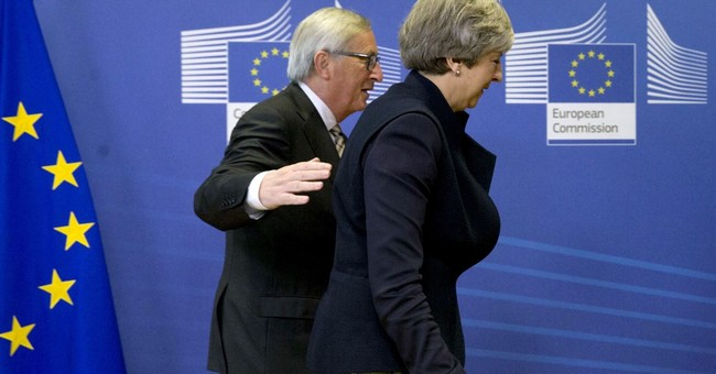 The Latest: EU official sees progress in key Brexit issue