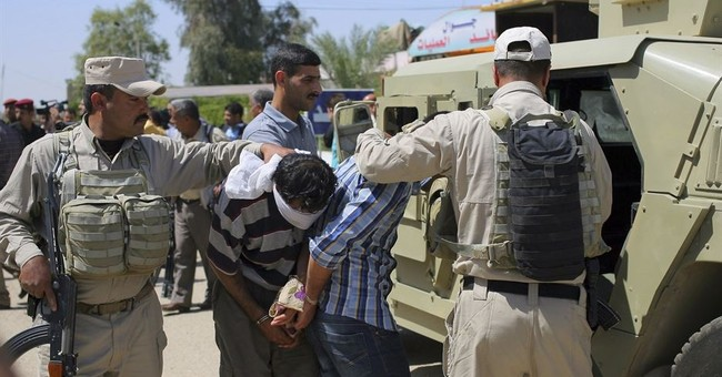 Rights group: IS suspects face violations in Iraqi custody