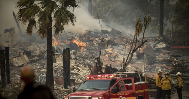 California communities under siege from wind-driven fires