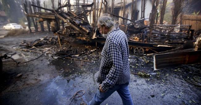 Hundreds flee as flames engulf California beachfront homes