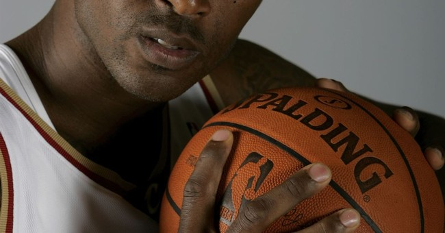 Man charged with 2010 slaying of NBA player Lorenzen Wright