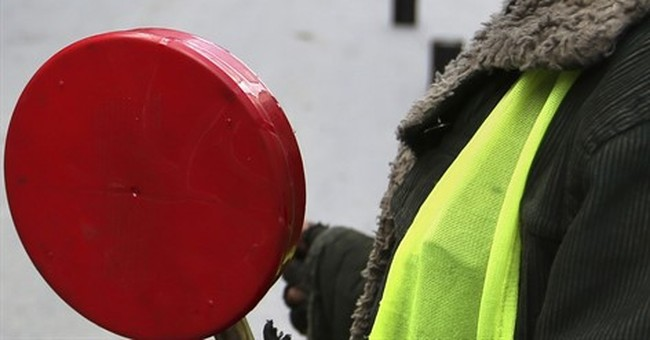 Afghan children direct traffic on mountain pass for $4 a day