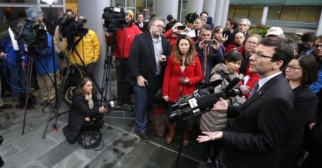 US judge temporarily blocks Trump's travel ban nationwide
