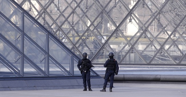 The Latest: Louvre attacker near death; said to be Egyptian