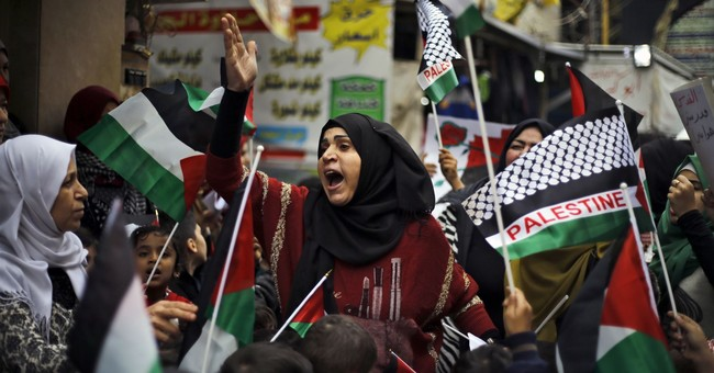 The Latest: Palestinians in Gaza burn US, Israel flags