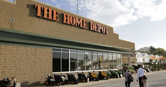 Home Depot sticks by outlook, buys back $15 billion in stock