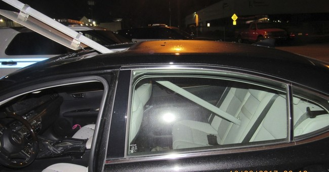 Police: Woman drove with transit sign sticking out of car
