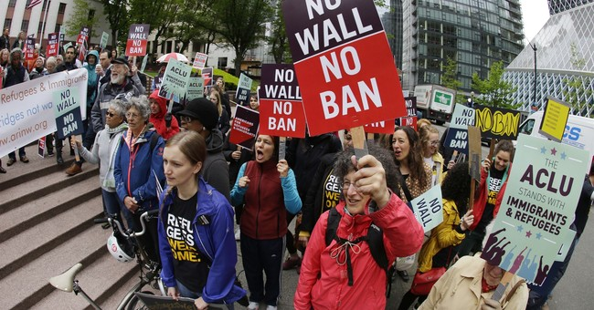 The Latest: Judges hear arguments in travel ban challenge