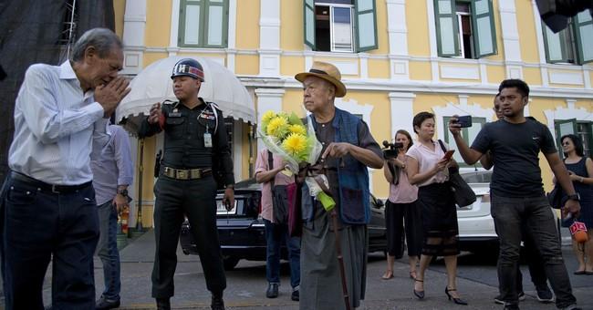 Thai court postpones decision on academic's charges