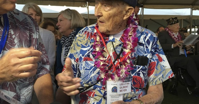 The Latest: Jets break silence for Pearl Harbor anniversary