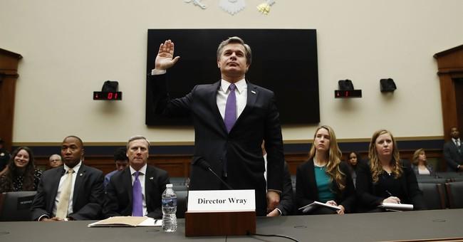 FBI director defends his agency against Trump's attacks