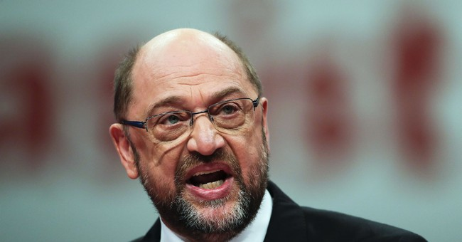 Germany's Social Democrats OK talks on a new Merkel govt