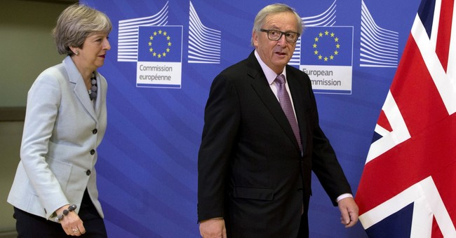 The Latest: Labour leader says 'wait and see' on Brexit deal