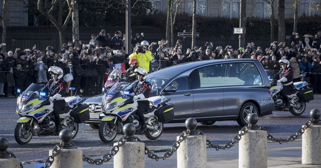 The Latest: Macron hails late rocker as 'a part of France'