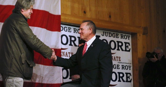 Expert concludes Roy Moore wrote disputed entry in accuser's yearbook, lawyer says