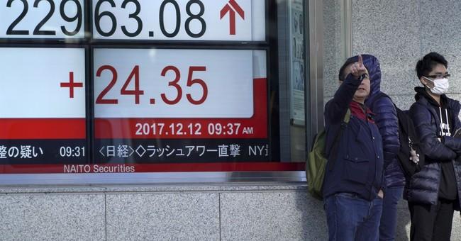 World stocks turn higher as investors eye Fed decision