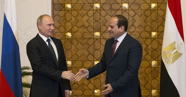 Putin visits Egypt in sign of closer ties