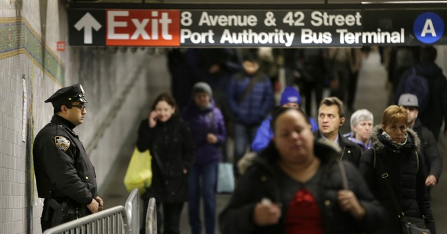 New York commuters return to bombing site, shrug off attack