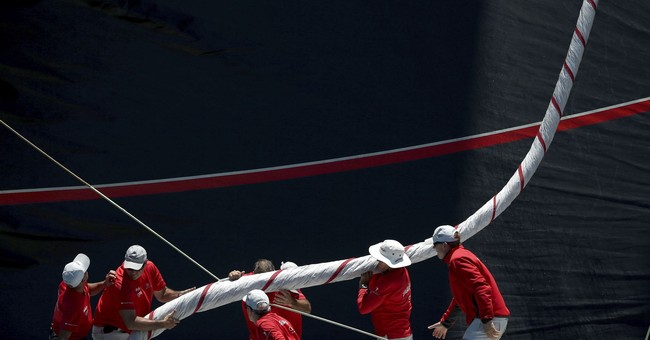 Image of Asia: Preparing a sail for yacht race