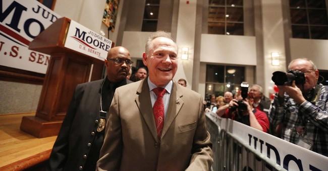 The Latest: Moore not conceding Senate race to Jones