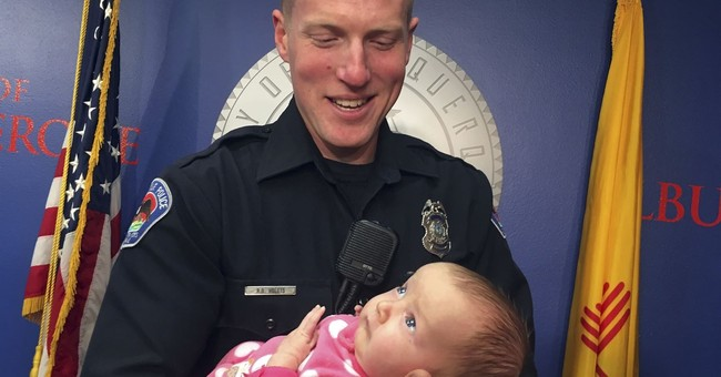 Officer honored for adopting baby from opioid addicted mom