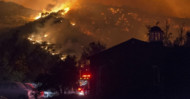 The Latest: Homeless camp fire sparked Los Angeles blaze