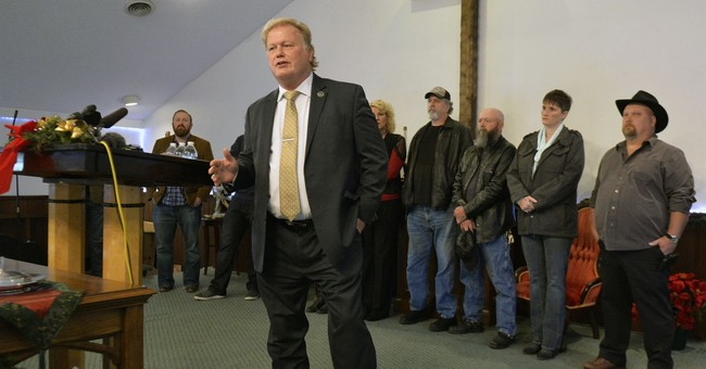 Kentucky lawmaker won't resign; says assault claim false