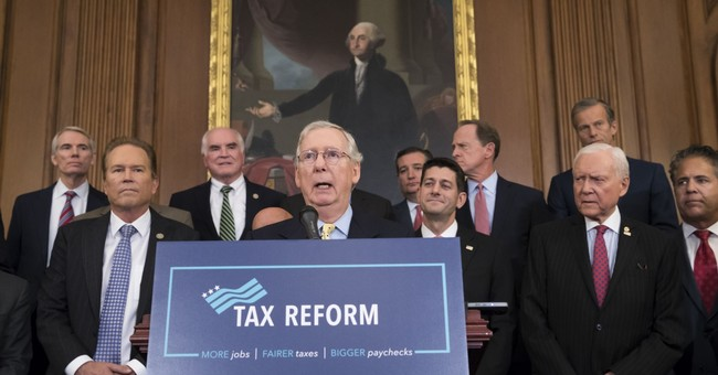 The Latest: GOP agrees to lower top tax rate for individuals