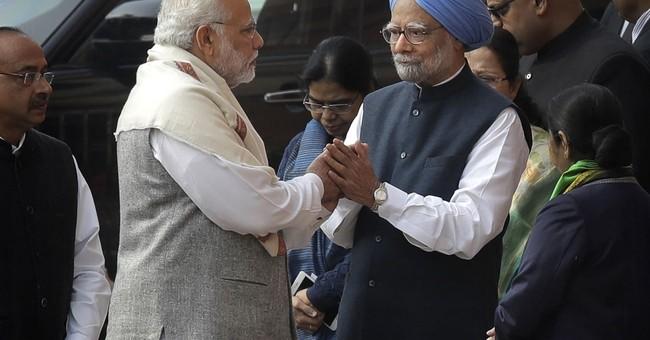 India's Modi duels with his predecessor amid local election