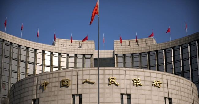 China reacts to Fed rate hike by nudging up key policy rate