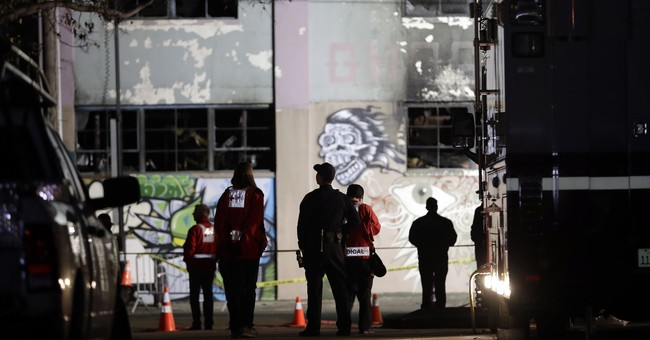 The Latest: 2 will go to trial in deadly warehouse fire