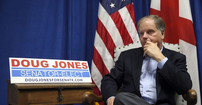 The Latest: Jones takes pass on  timing of Senate tax vote
