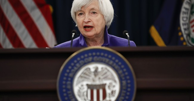 The Latest: China raises key policy rate after Fed's hike