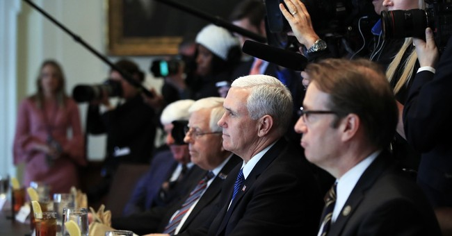 Pence to delay Mideast trip as tax deal nears vote