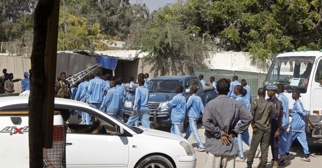 The Latest: Suicide bomber kills 17 at Somali police academy