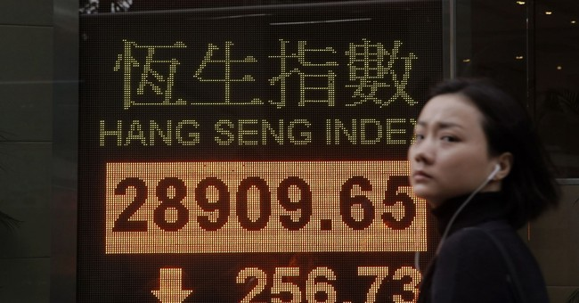 Asian stocks mostly lower as US tax bill uncertainty weighs