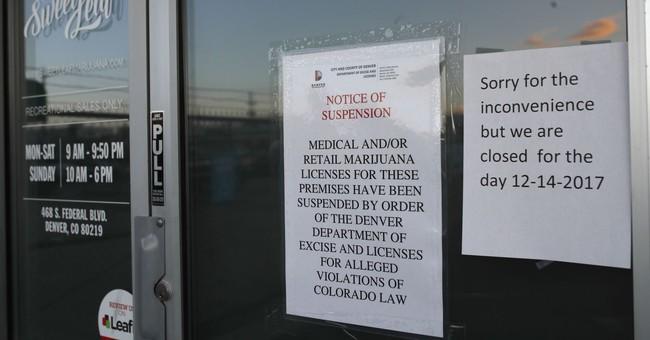 Denver shuts down 26 legal pot businesses, makes arrests