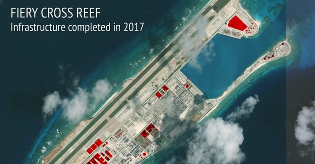 As tensions ease, China keeps building on disputed islands