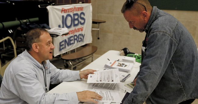 Applications for US jobless aid drop by 11,000 to 225,000