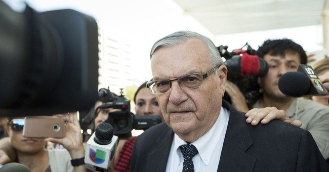 Arpaio accused of trumping up charges in dog deaths case