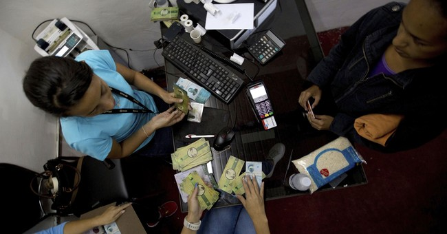Poor Venezuelans launch local currency amid cash crunch