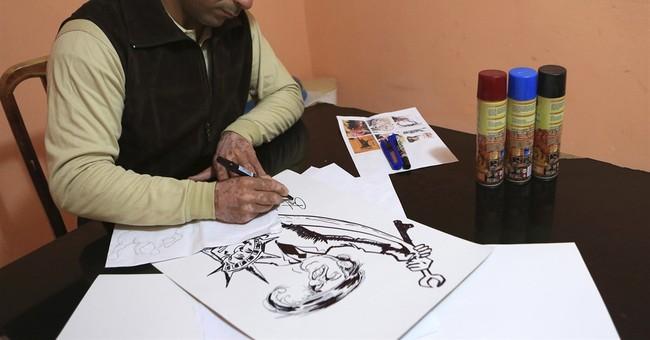 Iraqi artist protests Trump ban with graffiti