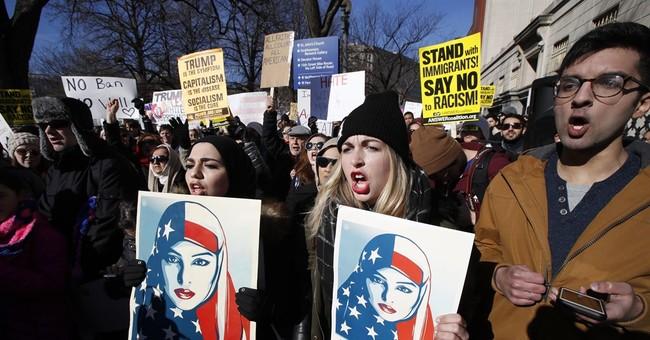 US suspends enforcement of travel ban, DOJ appeals