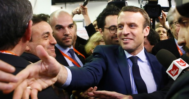 French presidential candidate Macron cheered by Lyon rally